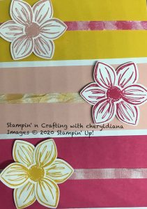 Close up of stamped ribbons on front of card